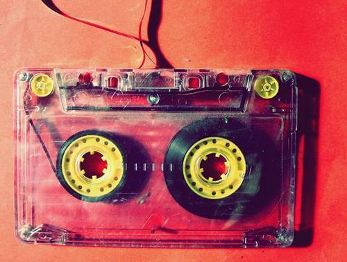 A cassette on a red background.
