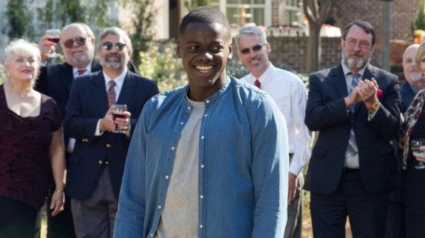 A man being clapped in Get Out movie.