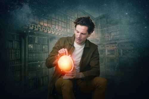 A man holding a glowing orb.
