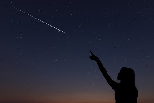 A woman seeing a shooting star.