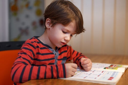 A child writing on a book.