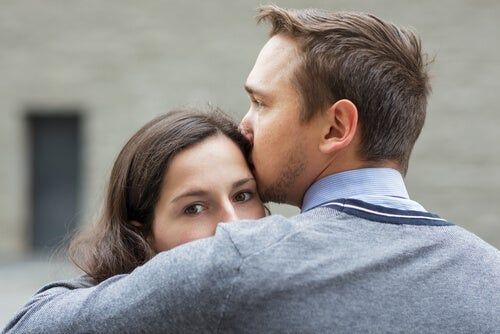 A couple embracing.