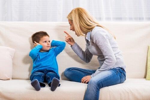 A mother scolding her child, representing behavior modification in children.