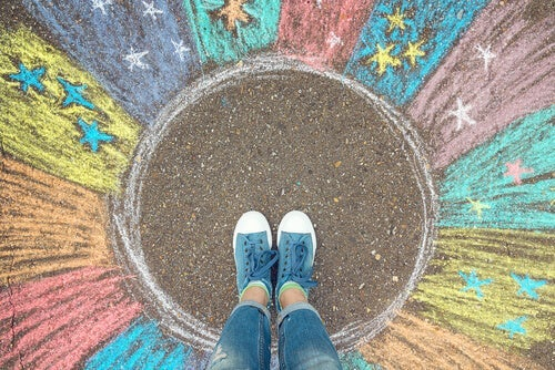 A person standing in a circle representing their comfort zone or familiar zone.