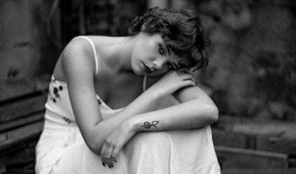A sad girl sitting.