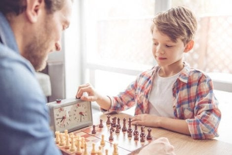 A man and a boy playing chess.