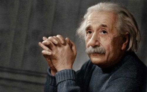 Albert Einstein listening intently.
