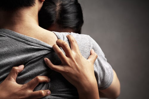 Two people hugging.