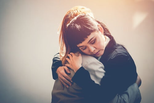 Two women hugging.