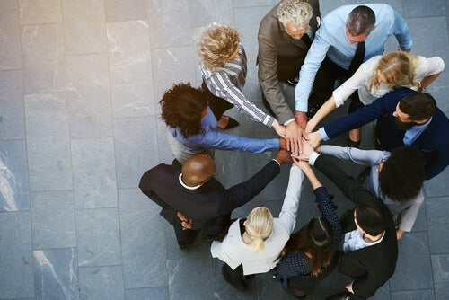 A group of workers showing group cohesion by sticking together at work.