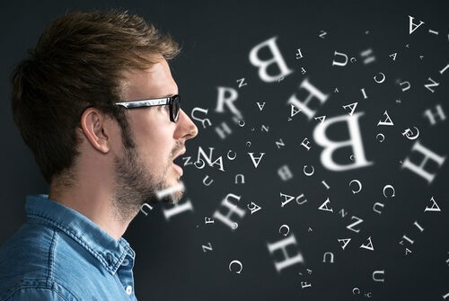 A man surrounded by letters.