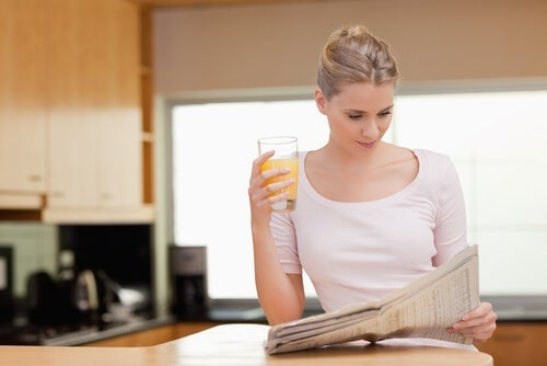 A woman reading the morning news.