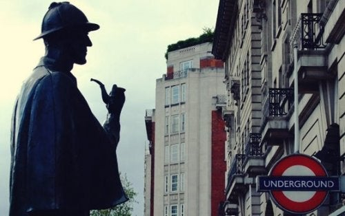Sherlock Holmes looking at a building.