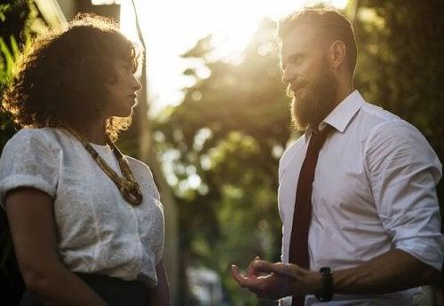 A man talking to a woman.