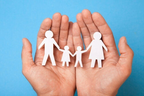 Systems psychology analyzes groups such as this representation of a family in someones hand.