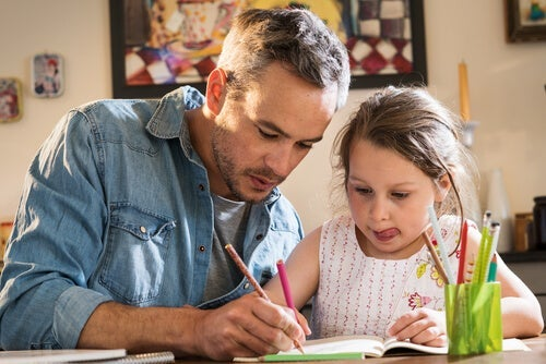 A man helping his daughter with her homework which can be very beneficial for children's education.