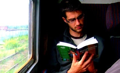 A man reading on a train.
