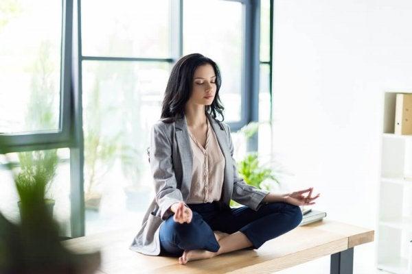 A woman meditating at home.