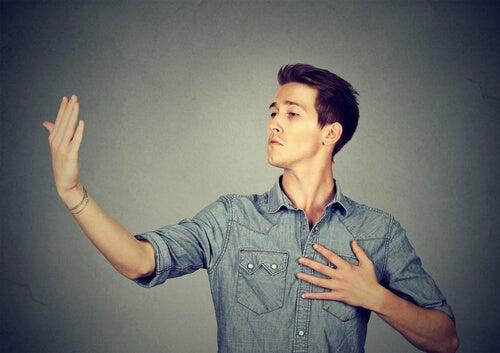 A man making narcissistic gestures.