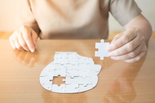 A person completing a head jigsaw puzzle that isn't a part of the mini-mental test.
