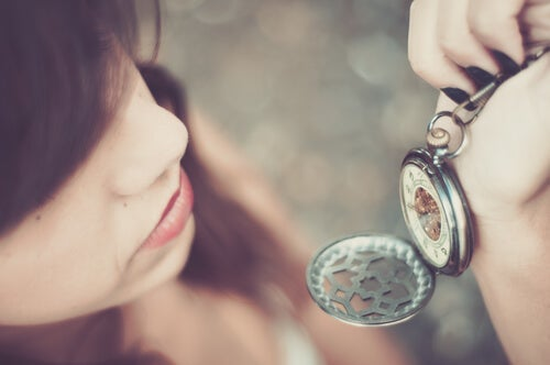 A person looking at a pocket watch.