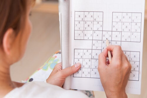 A woman doing a Sudoku.