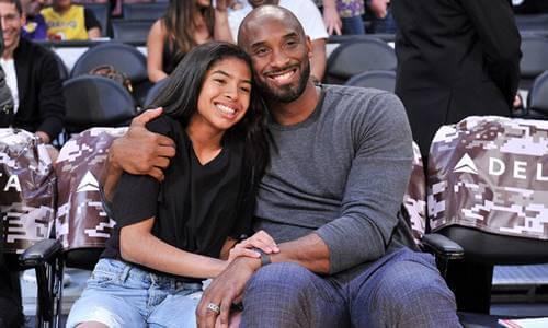 Kobe Bryant hugging his daughter.