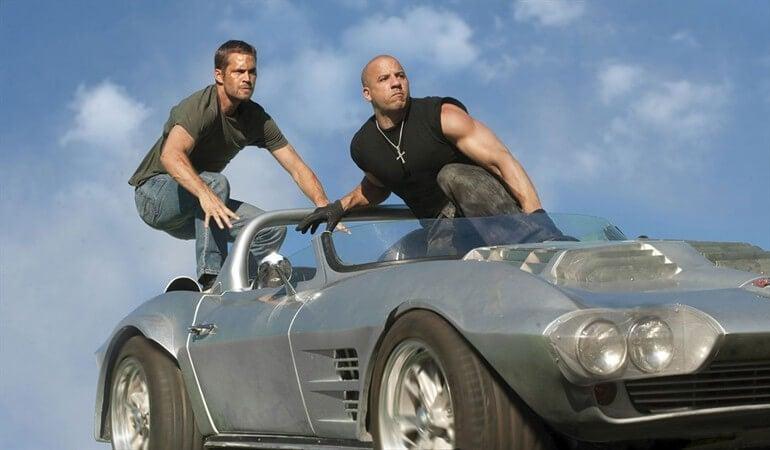 Two of the Fast and Furious characters on a car.