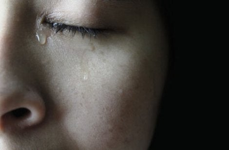 A woman crying.