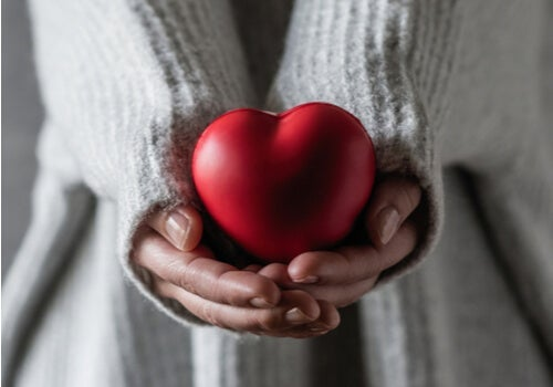 A woman holding a heart.