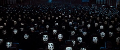 Crowd with Guy Fawkes masks.