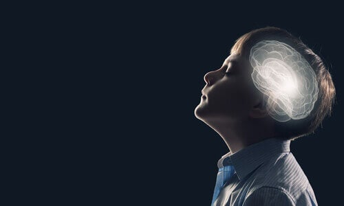 A child with his eyes closed and an image of his brain.