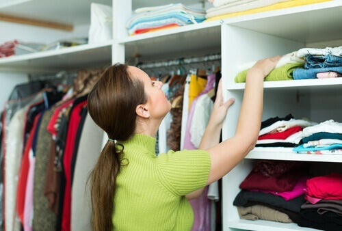 A woman looking for something in her closet.