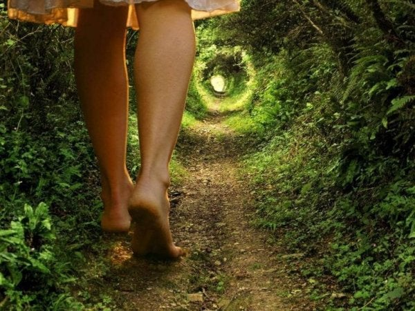 A woman walking down a path with spiral.