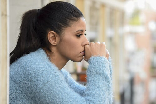 A woman who looks sad because of Blue Monday.