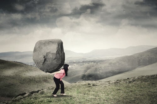 A woman carrying a big rock.