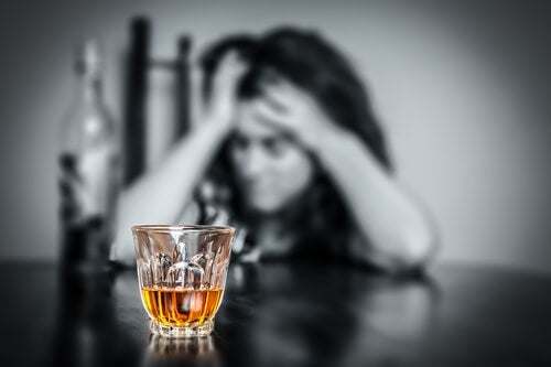 A woman dying to have a drink representing self-deception in alcoholism.