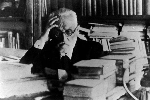 Miguel Unamuno seated at his desk.