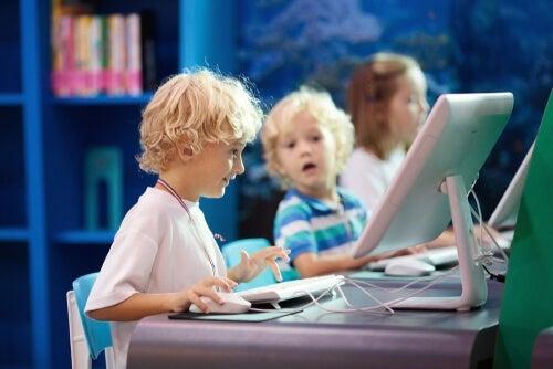 Three children in a computer lab.