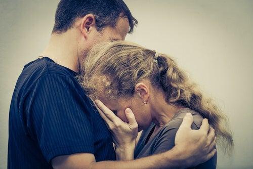 An older couple hugging.