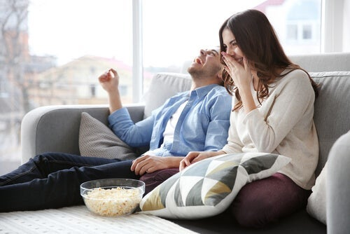A couple watching a film.