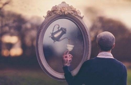 A surreal picture of a man being served tea from a mirror.
