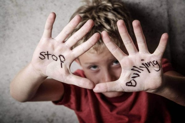 A boy with a stop bullying message.