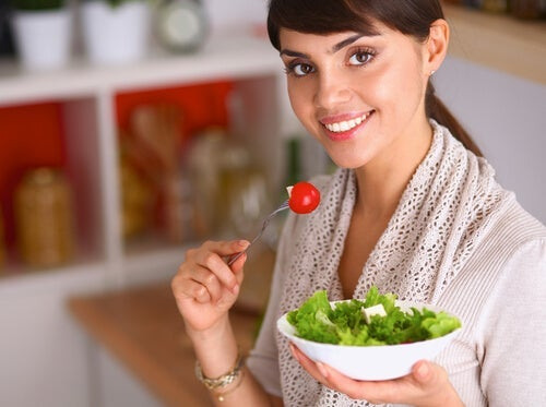 A woman fighting calcium and magnesium definciency by eating salad.