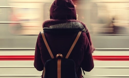 A woman in front of a moving train.