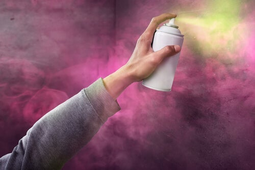 A person spraying paint.