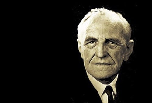 Donald Woods Winnicott with a black background.