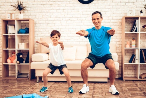 A father and son exercising.