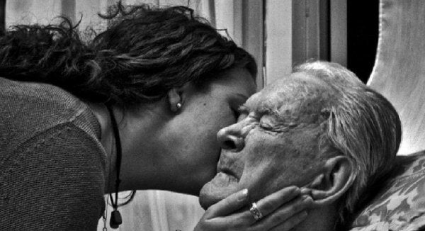 A woman kissing her elderly relative.