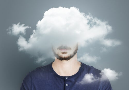 A man with his head in a cloud.